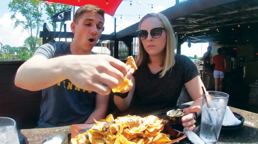 The couple chow down on nachos at Cowboy Jack's in Altoona. (Submitted photo)