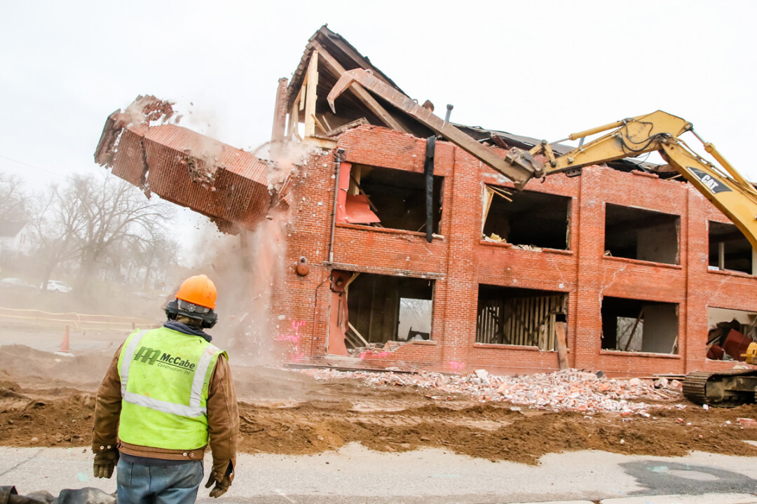A demolition crew ripped down the Huebsch building on N. Dewey Street in downtown Eau Claire on November 29. The 20,000-square-foots brick building was building around 1907.